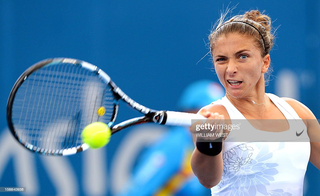 Sara Errani of Italy hits a forehand return during her match against Daniela Hantuchova of Slovakia in the second round of the Brisbane International tennis tournament on January 1, 2013. AFP PHOTO/William WEST USE