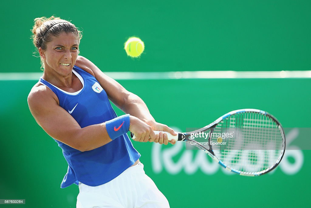 Sara Errani of Italy hits during the women's third round singles match against Daria Kasatkina of Russia on Day 4 of the Rio 2016 Olympic Games at...