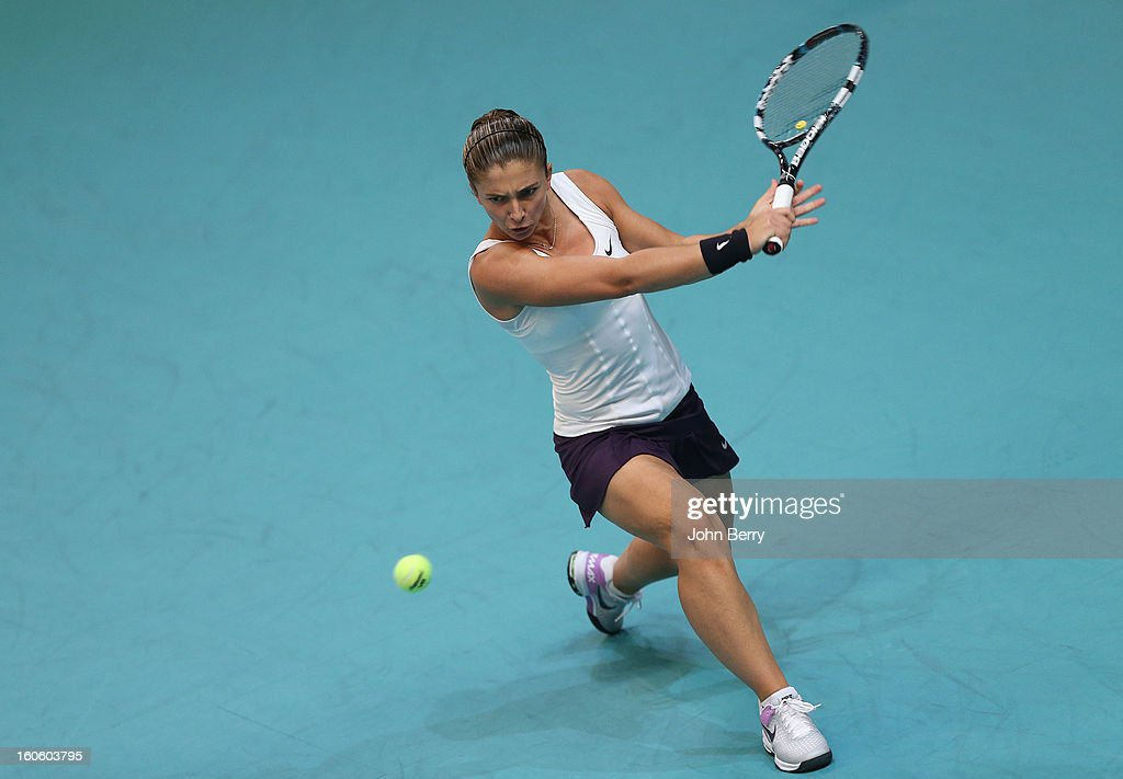 <a gi-track='captionPersonalityLinkClicked' href=/galleries/search?phrase=Sara+Errani&family=editorial&specificpeople=599213 ng-click='$event.stopPropagation()'>Sara Errani</a> of Italy in action against Mona Barthel of Germany during the final of the Open GDG Suez 2013 at the Stade Pierre de Coubertin on February 3, 2013 in Paris, France.