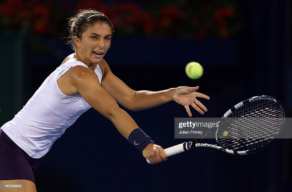 <a gi-track='captionPersonalityLinkClicked' href=/galleries/search?phrase=Sara+Errani&family=editorial&specificpeople=599213 ng-click='$event.stopPropagation()'>Sara Errani</a> of Italy in action in her match against Sorana Cirstea of Romania during day three of the WTA Dubai Duty Free Tennis Championship on February 20, 2013 in Dubai, United Arab Emirates.