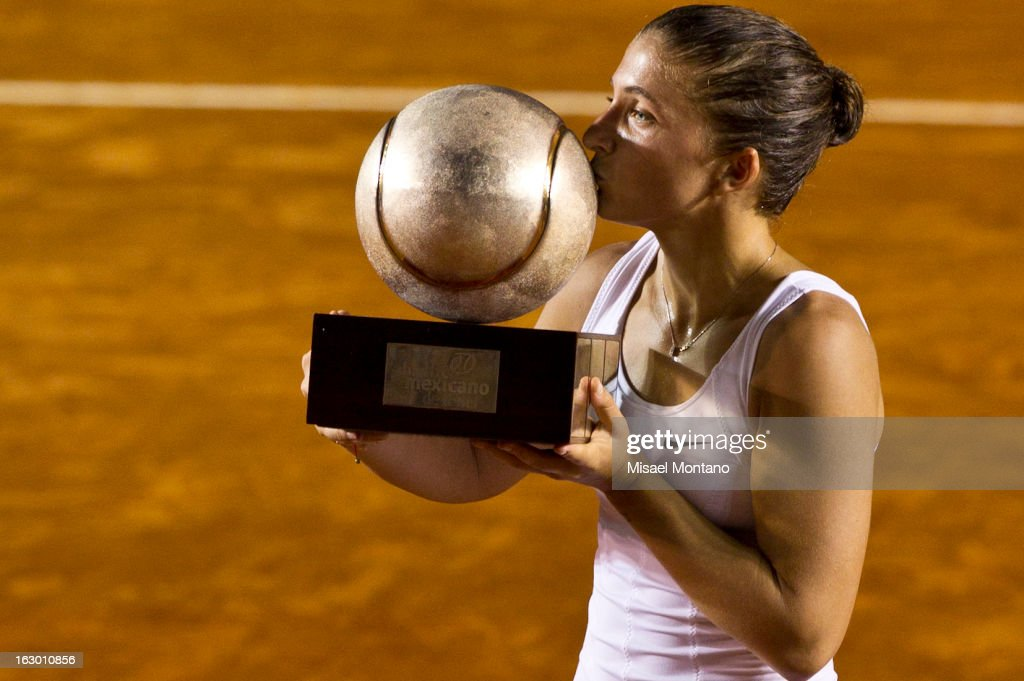 Sara Errani of Italy kissess the trophy after winning the match against Carla Suarez of Spain during the final round at the ATP Mexican Open Telcel on March 1, 2013 in Acapulco, Mexico.