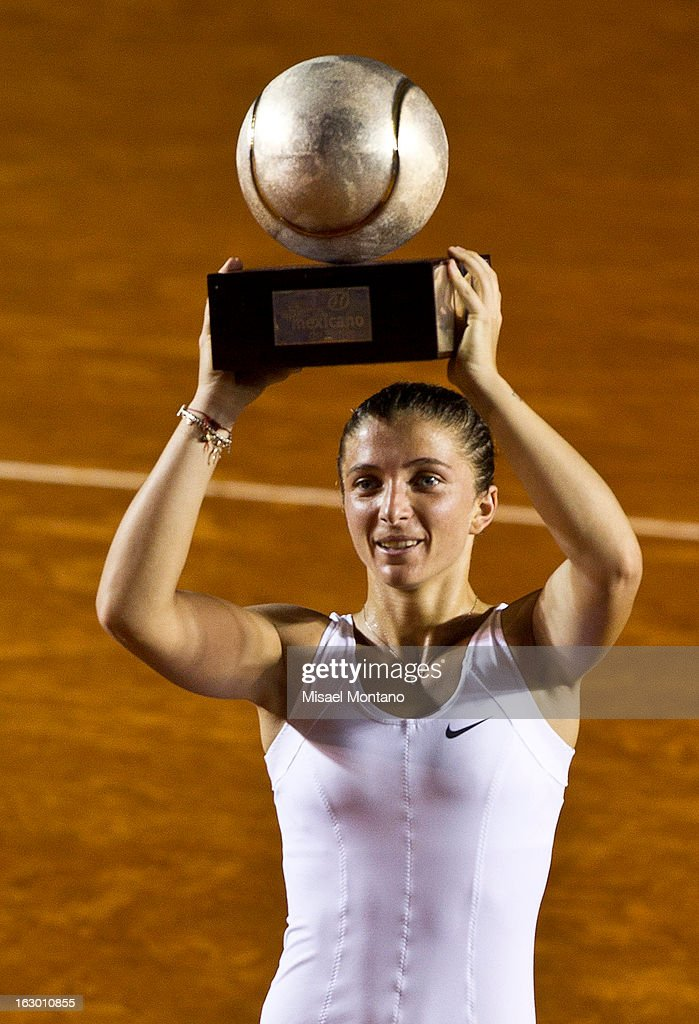 Sara Errani of Italy lifts the trophy after winning the match against Carla Suarez of Spain during the final round at the ATP Mexican Open Telcel on March 1, 2013 in Acapulco, Mexico.