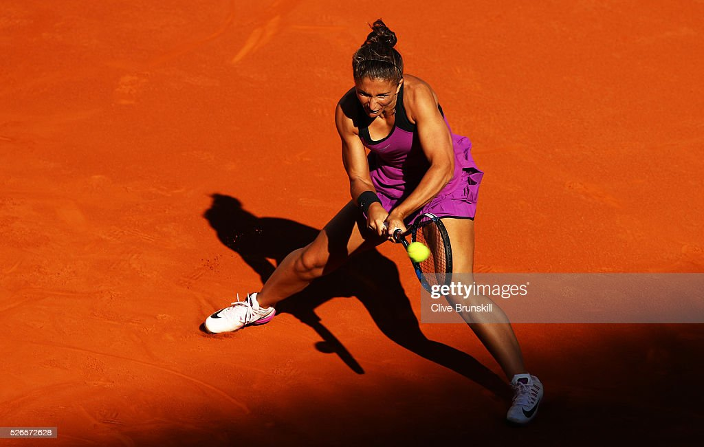 Sara Errani of Italy plays a backhand against Camila Giorgi of Italy in their first round match during day one of the Mutua Madrid Open tennis tournament at the Caja Magica on April 30, 2016 in Madrid, Spain. .