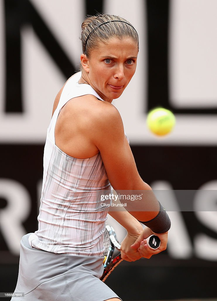 Sara Errani of Italy plays a backhand against Maria Kirilenko of Russia in their third round match during day five of the Internazionali BNL d'Italia 2013 at the Foro Italico Tennis Centre on May 16, 2013 in Rome, Italy.