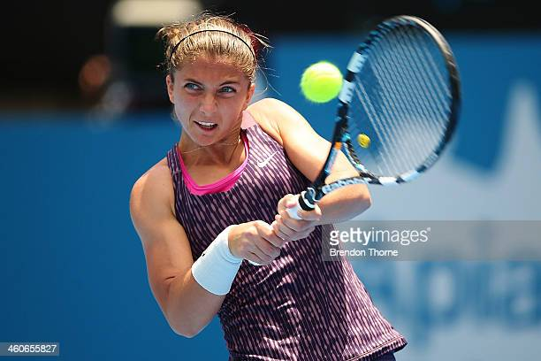 Sara Errani of Italy plays a backhand in her first round match against Roberta Vinci of Italy during day one of the Sydney International at Sydney...