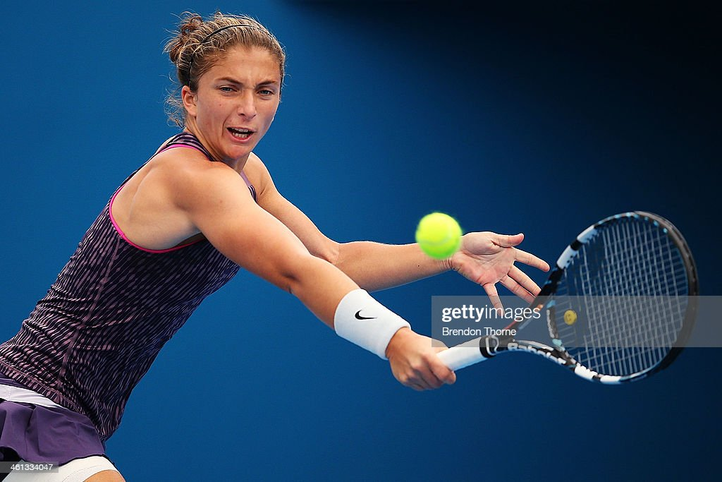 Sara Errani of Italy plays a backhand in her quarter final match against Tsvetana Pironkova of Bulgaria during day four of the 2014 Sydney International at Sydney Olympic Park Tennis Centre on January 8, 2014 in Sydney, Australia.