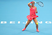 Sara Errani of Italy plays a forehand against Petra Kvitova of The Czech Republic during day two of the 2015 China Open at the China National Tennis...