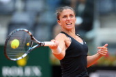 Sara Errani of Italy plays a forehand in her match against Li Na of China during day six of the Internazionali BNL d'Italia tennis 2014 on May 16...