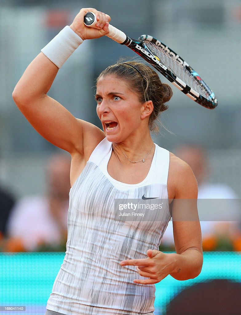 <a gi-track='captionPersonalityLinkClicked' href=/galleries/search?phrase=Sara+Errani&family=editorial&specificpeople=599213 ng-click='$event.stopPropagation()'>Sara Errani</a> of Italy plays a forehand in her match against Urszula Radwanska of Poland during the Mutua Madrid Open tennis tournament at the Caja Magica on May 4, 2013 in Madrid, Spain.
