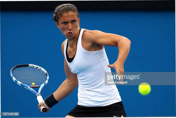 Sara Errani of Italy plays a forehand in her third round match against Sorana Cirstea of Romania during day six of the 2012 Australian Open at...