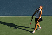 Sara Errani of Italy reacts after losing a point against Svetlana Kuznetsova of Russia during their match in the Mercury Insurance Open at La Costa...