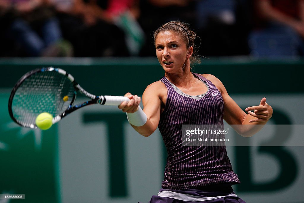 <a gi-track='captionPersonalityLinkClicked' href=/galleries/search?phrase=Sara+Errani&family=editorial&specificpeople=599213 ng-click='$event.stopPropagation()'>Sara Errani</a> of Italy returns a forehand to Li Na of China during day two of the TEB BNP Paribas WTA Championships at the Sinan Erdem Dome October 23, 2013 in Istanbul, Turkey.