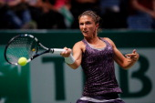 Sara Errani of Italy returns a forehand to Li Na of China during day two of the TEB BNP Paribas WTA Championships at the Sinan Erdem Dome October 23...