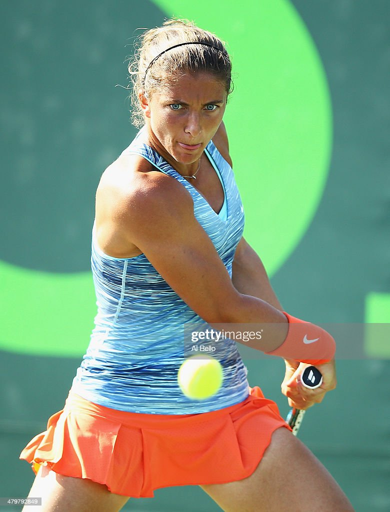 Sara Errani of italy returns a shot to Patricia Mayr-Achleitner during their match on day 4 of the Sony Open at Crandon Park Tennis Center on March 20, 2014 in Key Biscayne, Florida.
