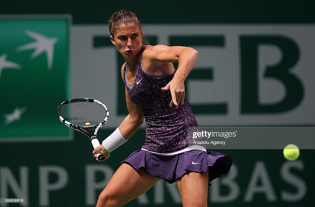 Sara Errani of Italy returns the ball to Li Na of China during their TEB BNP Paribas WTA Championships match at Sinan Erdem Dome on October 23, 2013 in Istanbul, Turkey.