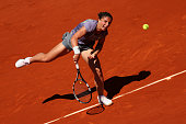 Sara Errani of Italy serves during her Women's Singles quarterfinal match against Agnieszka Radwanska of Poland on day ten of the French Open at...