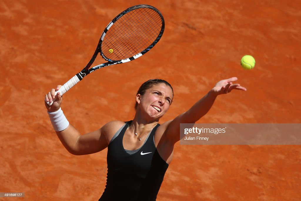 <a gi-track='captionPersonalityLinkClicked' href=/galleries/search?phrase=Sara+Errani&family=editorial&specificpeople=599213 ng-click='$event.stopPropagation()'>Sara Errani</a> of Italy serves in her match against Jelena Jankovic of Serbia during day seven of the Internazionali BNL d'Italia tennis 2014 on May 17, 2014 in Rome, Italy.