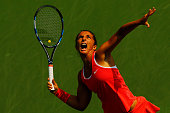 Sara Errani of Italy serves to Jelena Ostapenko of Latvia during their Women's Singles Second Round match on Day Four of the 2015 US Open at the USTA...