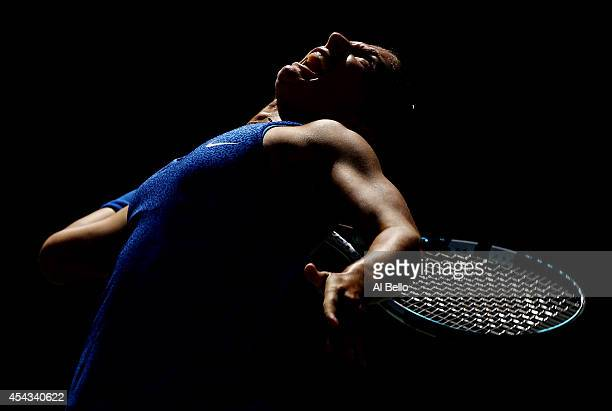 Sara Errani of Italy serves to Venus Williams of the United States during their women's singles third round match on Day Five of the 2014 US Open at...