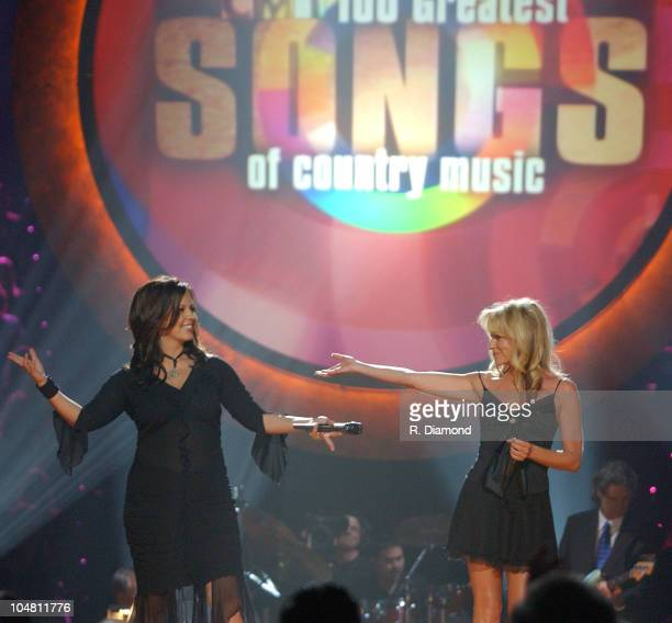 Sara Evans and Deana Carter during CMT 100 Greatest Songs of Country Music Taping to Air on Sunday June 8 2003 at Gaylord Center in Nashville TN...