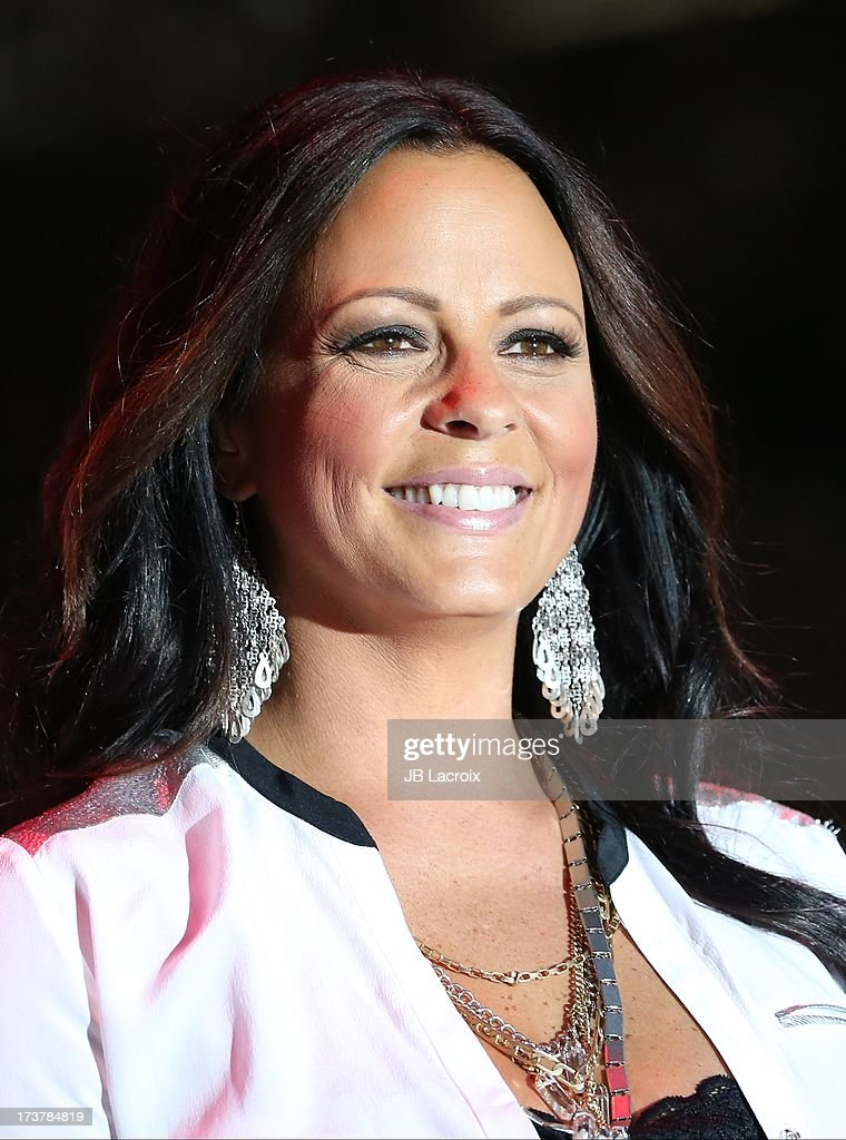 <a gi-track='captionPersonalityLinkClicked' href=/galleries/search?phrase=Sara+Evans&family=editorial&specificpeople=215184 ng-click='$event.stopPropagation()'>Sara Evans</a> performs at The Grove on July 17, 2013 in Los Angeles, California.