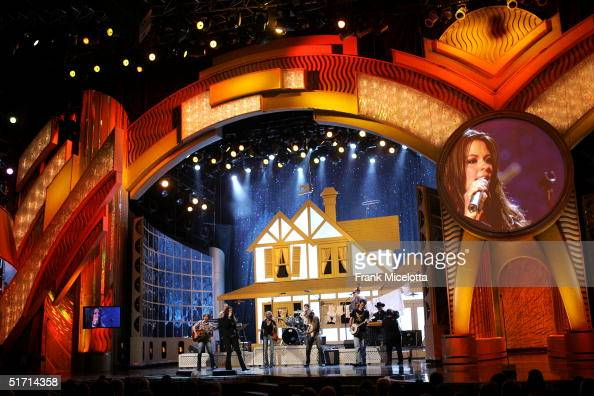 Sara Evans performs on stage at the 38th Annual CMA Awards at the Grand Ole Opry House November 9 2004 in Nashville Tennessee