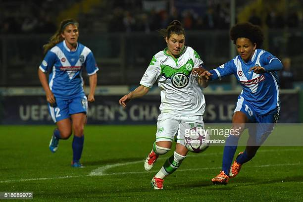 Sara Gama of Brescia competes with Ramona Bachmann of Wolfsburg during the UEFA Women's Champions League Quarter Final match between Brescia and...