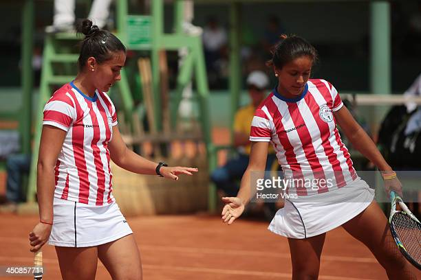 Sara Gimenez and Veronica Cepede of Paraguay celebrate during a Tennis match as part of the XVII Bolivarian Games Trujillo 2013 at Luz Marina Neyra...