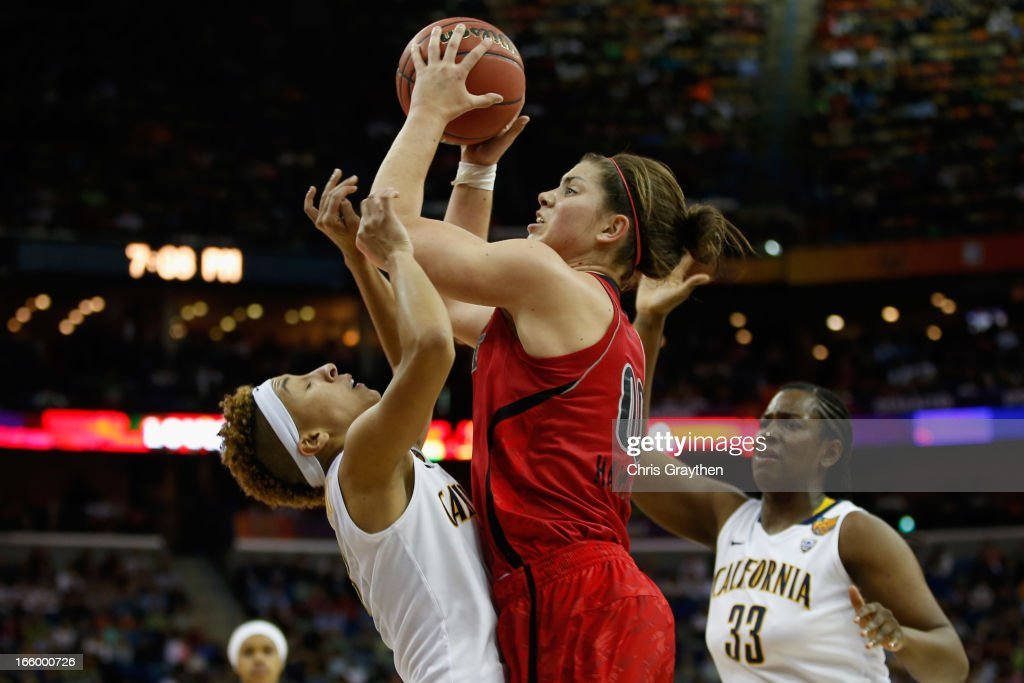 Sara Hammond #00 of the Louisville Cardinals shoots the ball over Layshia Clarendon #23 of the California Golden Bears during the National Semifinal game of the 2013 NCAA Division I Women's Basketball Championship at the New Orleans Arena on April 7, 2013 in New Orleans, Louisiana.