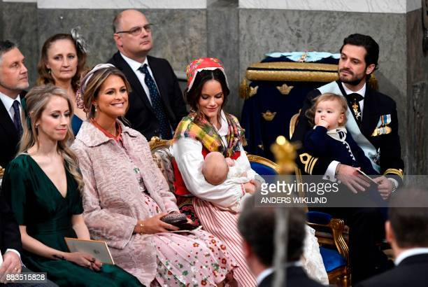 Sara Hellqvist princess Madeleine princess Sofia holding baby prince Gabriel and prince Carl Philip with prince Alexander sit during prince Gabriel's...