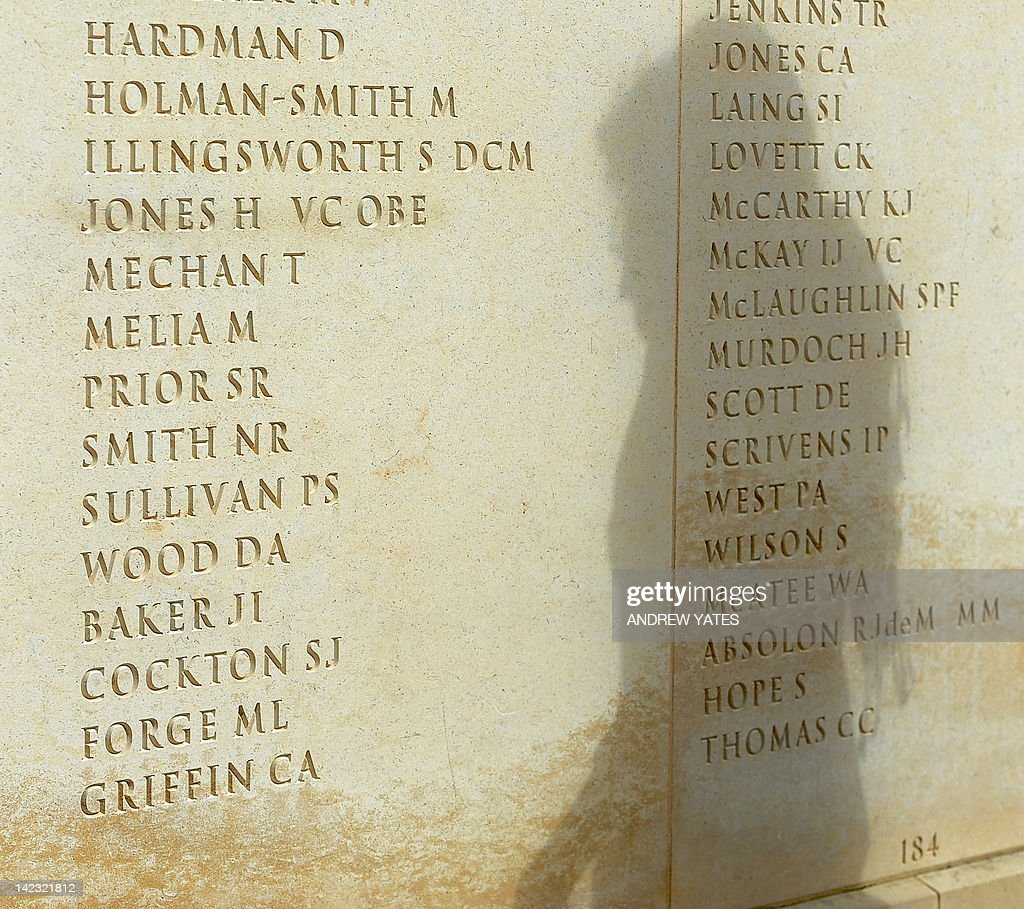 Sara Jones, wife of Falklands veteran Lieutenant Colonel Herbert Jones VC OBE, who was killed during the battle for Goose Green, on May 28, 1982, is shadowed as she looks at his name (4th from Top L) engraved on a memorial wall dedicated to British service personnel killed in military action since World War 2 at the National Memorial Arboretum in Staffordshire, central England, on April 2, 2012. Britain and Argentina on Monday marked 30 years since an Argentinian invasion of the Falklands triggered a bloody 74-day war, amid renewed tensions between London and Buenos Aires. AFP PHOTO/ANDREW YATES