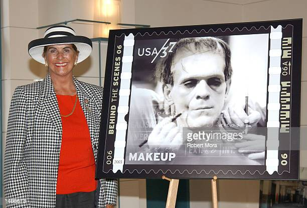 Sara Karloff unveils one of the new 'American Filmmaking Behind the Scenes' postage stamps which portrays her father/actor Boris Karloff as...