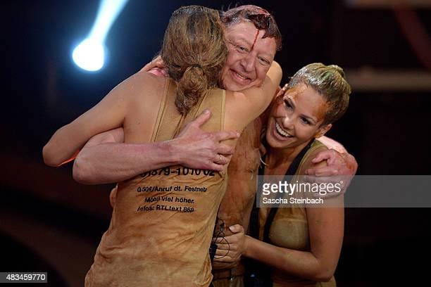 Sara Kulka Walter Freiwald and Angelina Heger react during the final of the television show 'Ich bin ein Star lasst mich wieder rein' on August 8...