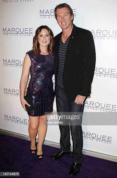 Sara Leonardi and Glenn McGrath pose on the red carpet during the opening of Marquee Nightclub at The Star on March 30 2012 in Sydney Australia