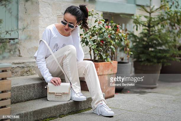 Sara Liscia is wearing a Heavenking white top Zara white pants Adidas Superstar shoes a Zara white bag and Dior sunglasses during a street style...