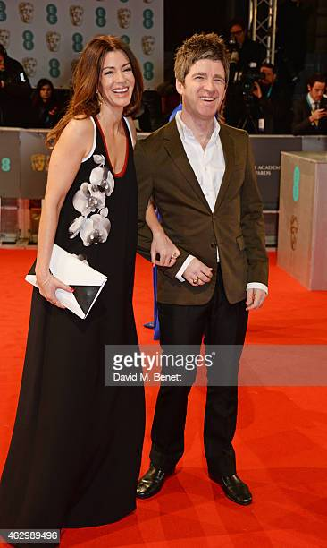 Sara Macdonald and Noel Gallagher attend the EE British Academy Film Awards at The Royal Opera House on February 8 2015 in London England