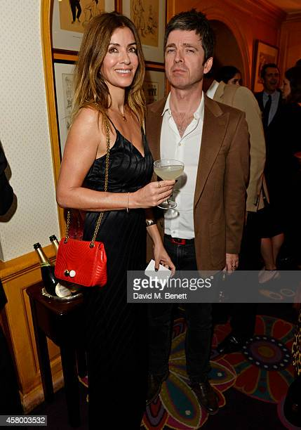 Sara Macdonald and Noel Gallagher attend the launch of Annabel's DocuFilm 'A String of Naked Lightbulbs' at Annabel's on October 28 2014 in London...