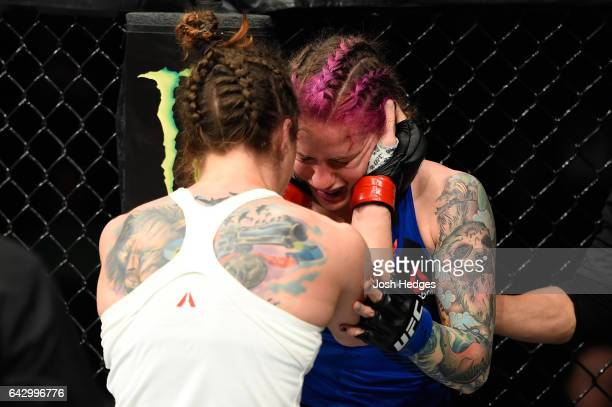 Sara McMann consoles Gina Mazany in their women's bantamweight fight during the UFC Fight Night event inside the Scotiabank Centre on February 19...