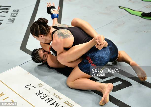 Sara McMann elbows Ketlen Vieira of Brazil in their women's bantamweight bout during the UFC 215 event inside the Rogers Place on September 9 2017 in...