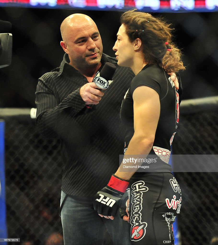 Sara McMann is interviewed by commentator Joe Rogan after a women's bantamweight bout during UFC 159 Jones v. Sonnen at Prudential Center in Newark, New Jersey.