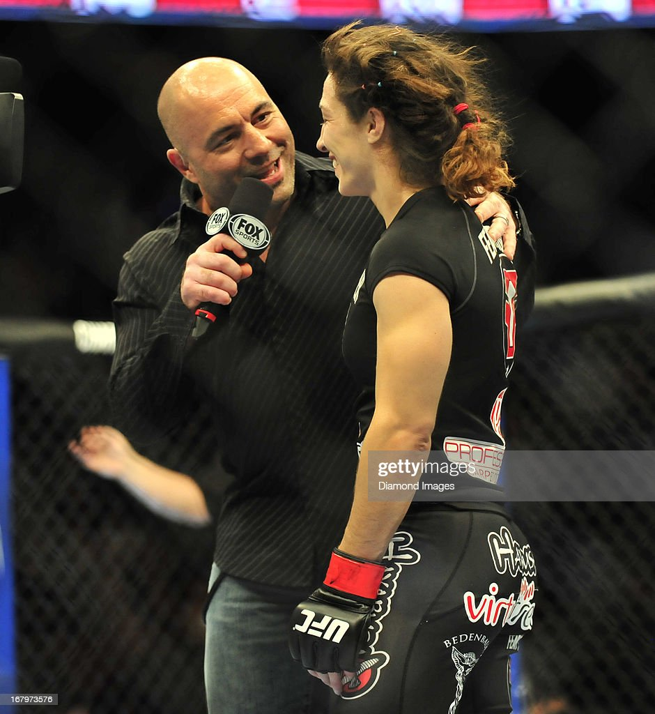 <a gi-track='captionPersonalityLinkClicked' href=/galleries/search?phrase=Sara+McMann&family=editorial&specificpeople=171852 ng-click='$event.stopPropagation()'>Sara McMann</a> is interviewed by commentator <a gi-track='captionPersonalityLinkClicked' href=/galleries/search?phrase=Joe+Rogan&family=editorial&specificpeople=206681 ng-click='$event.stopPropagation()'>Joe Rogan</a> after a women's bantamweight bout during UFC 159 Jones v. Sonnen at Prudential Center in Newark, New Jersey.