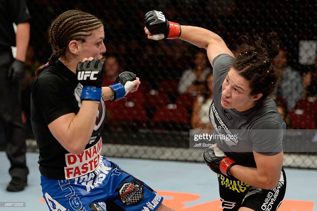 <a gi-track='captionPersonalityLinkClicked' href=/galleries/search?phrase=Sara+McMann&family=editorial&specificpeople=171852 ng-click='$event.stopPropagation()'>Sara McMann</a> punches Lauren Murphy in their women's bantamweight bout during the UFC fight night event at the Cross Insurance Center on August 16, 2014 in Bangor, Maine.