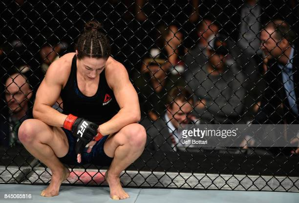 Sara McMann reacts to her submission loss to Ketlen Vieira of Brazil in their women's bantamweight bout during the UFC 215 event inside the Rogers...