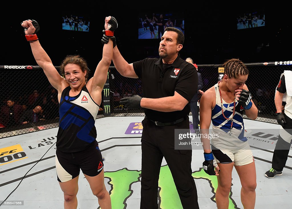 <a gi-track='captionPersonalityLinkClicked' href=/galleries/search?phrase=Sara+McMann&family=editorial&specificpeople=171852 ng-click='$event.stopPropagation()'>Sara McMann</a> (left) reacts to her victory over Jessica Eye (right) in their women's bantamweight bout during the UFC Fight Night event inside the Mandalay Bay Events Center on May 29, 2016 in Las Vegas, Nevada.