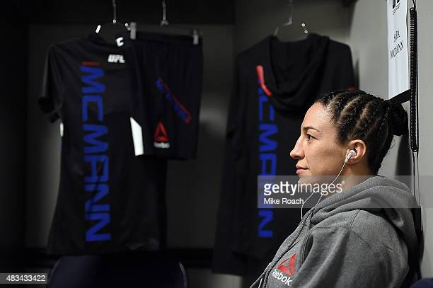 Sara McMann rests backstage in the locker room during the UFC Fight Night event at Bridgestone Arena on August 8 2015 in Nashville Tennessee