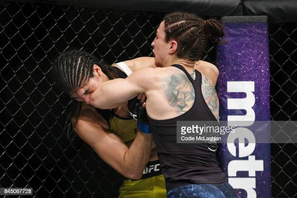 Sara McMann right fights Ketlen Vieira during UFC 215 at Rogers Place on September 9 2017 in Edmonton Canada