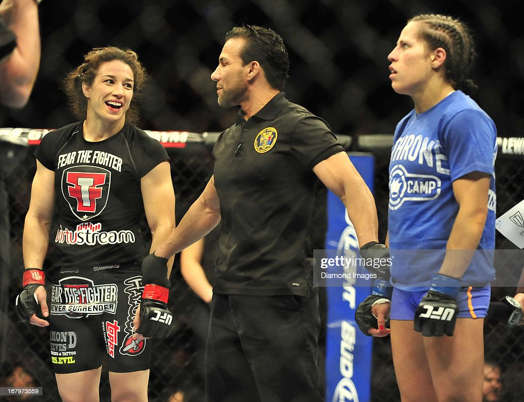 <a gi-track='captionPersonalityLinkClicked' href=/galleries/search?phrase=Sara+McMann&family=editorial&specificpeople=171852 ng-click='$event.stopPropagation()'>Sara McMann</a> smiles before having her arm raised in victory after a women's bantamweight bout during UFC 159 Jones v. Sonnen at Prudential Center in Newark, New Jersey.