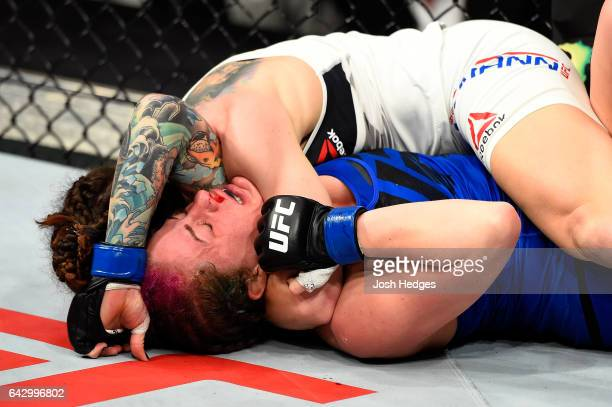Sara McMann submits Gina Mazany in their women's bantamweight fight during the UFC Fight Night event inside the Scotiabank Centre on February 19 2017...