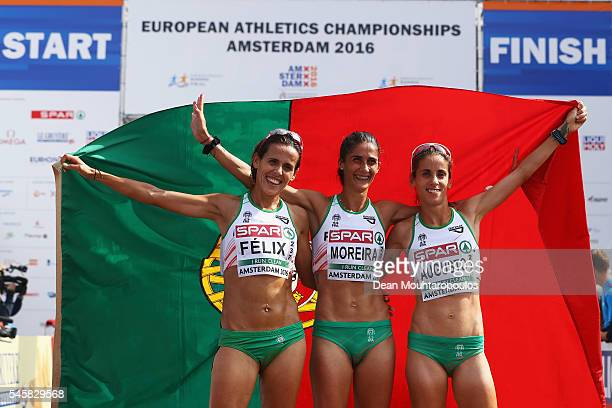 Sara Moreira of Portugal celebrates after she wins the gold medal in the Half Marathon Women with team mates Dulce Felix and Jessica Augusto who won...