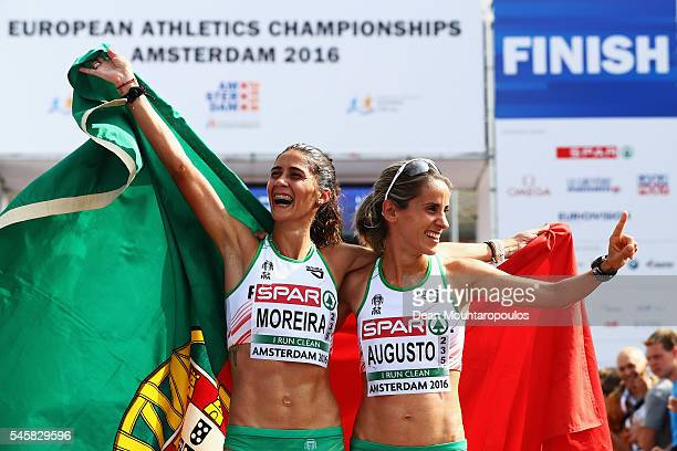 Sara Moreira of Portugal celebrates after she wins the gold medal in the Half Marathon Women with team mates and Jessica Augusto who won bronze on...